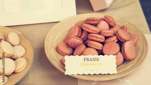 Fotobehang Macarons Strawberry flavored macarons in French open air market stand