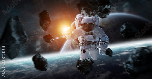 Astronaut floating in space 3D rendering elements of this image furnished by NASA - 211383988