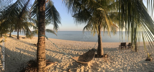 Hammock on white sand beach, Modessa Island, Palawan, Philippines