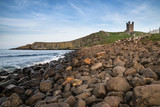 Landscape image of Dunstanburgh Castle on Northumberland coastline in England during late Spring evening - 211402163