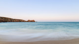 Stunning sunset landscape image of Porthcurno beach on South Cornwall coast in England - 211402321