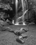 Beautiful calm black and white waterfall landscape at Roughting Linn in Northumberland National Park in England - 211402339