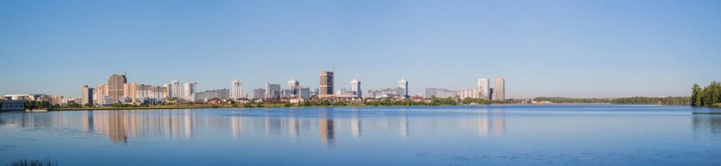 Landscape, bright day. City, water, sunny sky © SlavaK