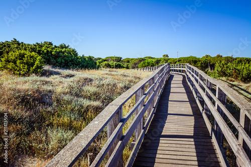 Aluminium Aubergine Wooden catwalk on the beach