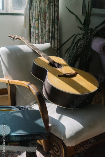 Acoustic Guitar in the sunlight in a lounge - 211414721