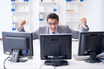 Businessman sitting in front of many screens © Elnur