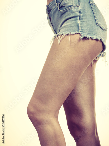 Slim girl wearing denim shorts side view - 211437914