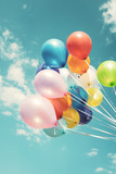 Colorful festive balloons over blue sky with a retro vintage instagram filter effect. - 211443595