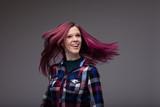 Carefree laughing woman flicking her purple hair - 211446149