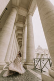 Pretty young bride in wedding dress in the Vatican - 211470910