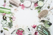 Leinwanddruck Bild - Spa and wellness background with  flowers, skin cosmetic products and others body care and massage accessories on white background, top view, frame with copy space