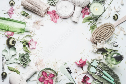 Fotobehang Spa Spa and wellness background with flowers, skin cosmetic products and others body care and massage accessories on white background, top view, frame with copy space