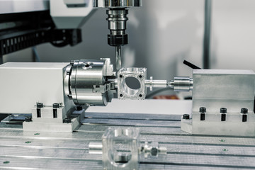 Precision milling CNC machine tool makes part. © nordroden