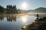 Magic sunrise by the dam lake in Rhodope mountain, Bulgaria.  A man is fishing early in the morning. - 211485931