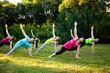 Group of women attending a yoga class outdoors