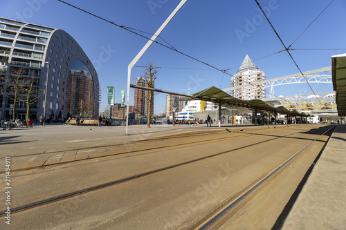Fotobehang Rotterdam ROTTERDAM, 13 Marc 2016 - View of the tram station on the market place where the colorful Marthal building lays in front the cubic houses in Rotterdam, Netherlands