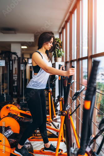 Wall mural Cute sporty girl workout in the gym