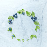 An arrangement of blueberries and mint leaves on gray marble background. Flat lay. Copy space. - 211497509