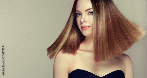 Beautiful model girl with shiny brown and straight long  hair .Keratin  straightening .Treatment, care and spa procedures.Medium length hairstyle. Coloring, ombre,and highlighting    © Sofia Zhuravetc