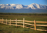 Wooden fence from the parallel boards, in the long term leaving in mountains - 211500336