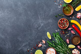 Different spices and herbs on black stone table top view. Ingredients for cooking. Food background. - 211500563