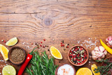 Set of spices and fresh rosemary on wooden kitchen table top view. Ingredients for cooking. Food background. - 211500593