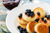 Delicious cottage cheese pancakes or curd fritters decorated honey and blueberry. Healthy and diet breakfast. - 211501552