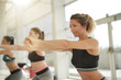 Leinwanddruck Bild - Women doing fitness exercises at the gym