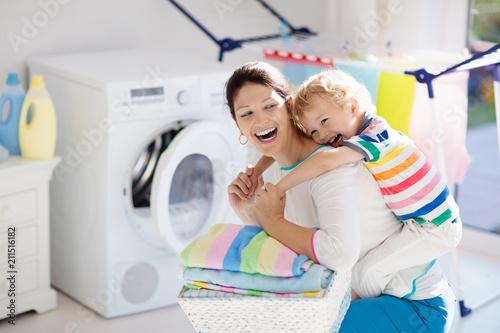 Leinwanddruck Bild Family in laundry room with washing machine