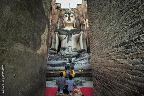 Aluminium Boeddha Buddha statue at Wat Si Chum, Sukhothai historical park, Thailand, Unesco world heritage.