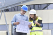 Construction engineers meeting outside building