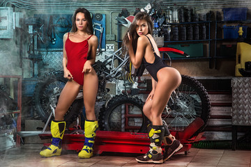 Sexy girls repairing motorcycle