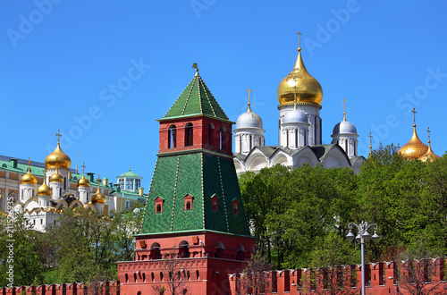 Cathedrals of Moscow Kremlin behind red kremlin wall