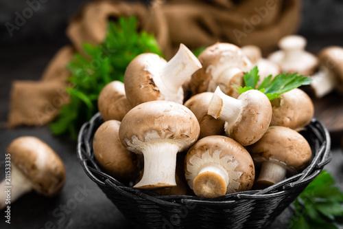 Fototapeta Mushrooms. Fresh mushrooms in basket