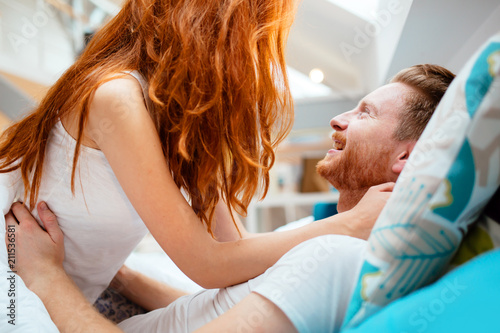 Passionate couple foreplay in bed - 211536581
