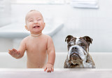 baby and dog in the tub © zmijak