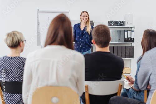 Attractive woman giving a presentation or lecture