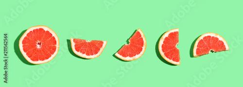 Halved fresh grapefruits on bright color background - 211562564