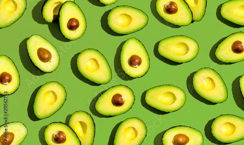 Fresh avocado pattern on a green background flat lay - 211562753