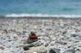 stack of zen stones on pebble beach - 211567352