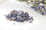 Dried lavender flowers over a white table. The concept of natural cosmetics and healthcare therapy. - 211573560