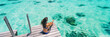 Luxury beach vacation travel destination woman relaxing on idyllic paradise blue turquoise clear water for snorkeling. Banner panorama with background texture on ocean.