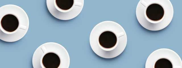 Many cups of coffee on blue background. Top view, banner for site. © zolga