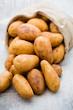 Leinwanddruck Bild - A bio russet potato wooden vintage background.