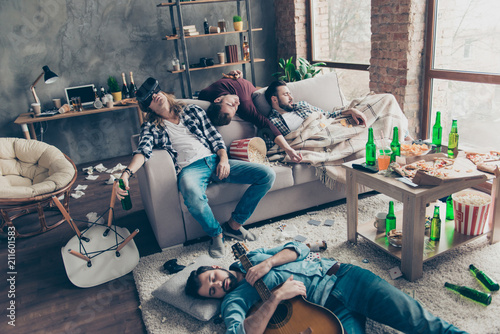 Leinwanddruck Bild It was great party! Bearded, exhausted, tired, drunk guys are sleeping after night events on the floor and sofa in different pose in living room, having a lot of litter, garbage, rubbish around them