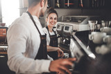 Cafe business, professional baristas team during work at cafe - 211605790