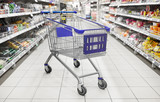 consumerism concept - empty shopping cart or trolley at supermarket - 211612785