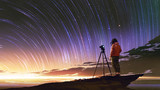 young photographer taking picture of sunrise sky with star trails, digital art style, illustration painting - 211622918