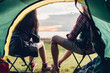 Leinwanddruck Bild - Young couple sitting discuss camping tent together
