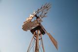 Vintage old wind motor under blue sky - 211627945